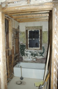 All tiles removed and window re-exposed.  You can still see the dropped ceiling framing in place.